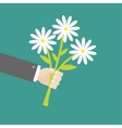 Businessman hand holding bunch bouquet of white vector image vector image