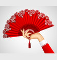 female hand with open vintage red fan isolated on vector image vector image