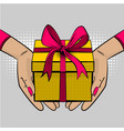 pop art woman hand hold gift box ribbon vector image