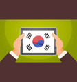 hands holding digital tablet with south korea flag vector image vector image