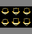 set of golden shields with ribbon vector image vector image