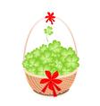 a brown basket lovely four leaf clovers vector image vector image