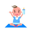 child with bottle on mat vector image vector image