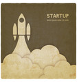 startup concept with rocket vintage background vector image