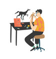 young man sitting at desk and painting handcrafted vector image