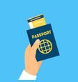 cartoon hand holding passport and boarding pass vector image