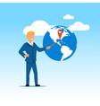 businessman pointing on earth globe with red mark vector image vector image