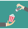 Popcorn Businessman hand Salt shacker vector image vector image