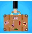 Briefcase with stickers in hand vector image vector image