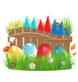Easter eggs near a wooden fence vector image vector image