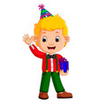 boy holding birthday gifts vector image vector image