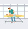 masseur doing massage on woman back in spa salon vector image