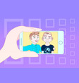 hand using smart phone for selfie photo of two vector image vector image