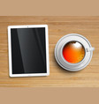a cup of tea with a tablet vector image vector image