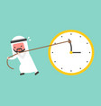 arab businessman try hard to pull back minute vector image vector image