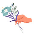 female hand holding flower in bloom with leaves vector image
