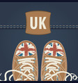 banner with brown sneakers and inscription uk vector image vector image