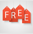 four large orange tags with the word free vector image vector image