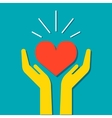 Heart in hands icon vector image