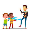 two bully kids splashing into man from water vector image vector image