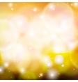 Shining abstract bokeh in gold vector image