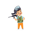 cute little boy playing paintball with gun wearing vector image vector image