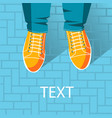top view of feet in sport boots and jeans vector image