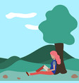 a woman sits reading a book in a park near a tree vector image