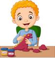 cute little boy making dinosaur from clay vector image