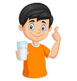 cartoon little boy with a glass milk vector image vector image