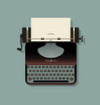 old typewriter with a sheet of paper and a vector image