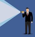 Businessman holding flashlight vector image vector image