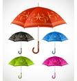 Umbrellas ornamental set vector image