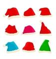 set of bright santa claus hats on christmas vector image