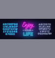 enjoy your life neon lettering on brick wall vector image vector image