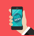 fake news word on smartphone vector image vector image