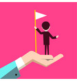 man with flag in human hand on pink background vector image vector image
