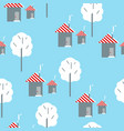 seamless pattern houses on a blue background vector image vector image