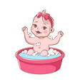 baby girl bathes cute infant in bathtub