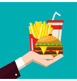 fast food in human hand flat design of hamburger vector image