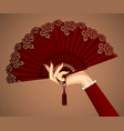 Female hand with open vintage fan isolated in