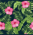 tropical leaves and hibiscus seamless dark blue vector image vector image