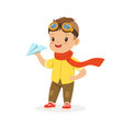 cute little boy in pilot glasses playing with vector image vector image