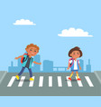 cheerful kids with red rucksacks crossing road vector image vector image