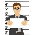 Arrested businessman posing for mugshot vector image vector image