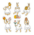 easter bunnies with eggs and flowers set vector image