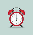 red alarm clock isolated on background vector image