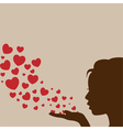 Woman blowing heart vector image