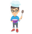 caucasian boy holding a saucepan and a spoon vector image vector image