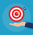 hand with target and arrow business concept vector image vector image